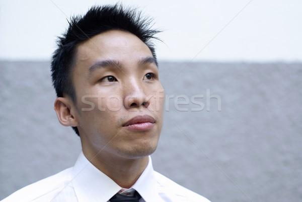 Aspiring asian male executive looking up Stock photo © palangsi