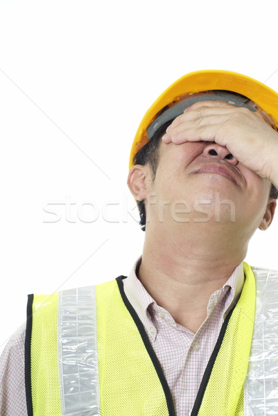 Asian construction contractor with regret expression on white background Stock photo © palangsi