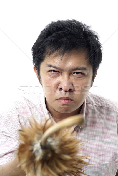 Angry male parent with feather duster cane on white background Stock photo © palangsi