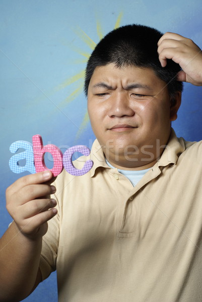 Man confused with abc letters Stock photo © palangsi