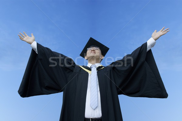 Happy asian male graduate with sky Stock photo © palangsi
