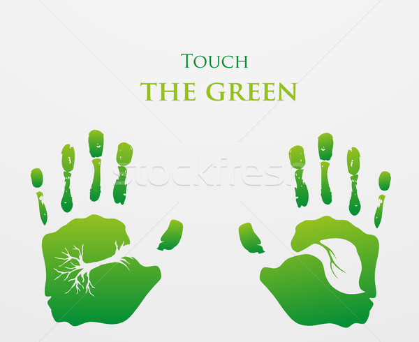 caring for the environment, arms out of the grass with a green Stock photo © Panaceadoll
