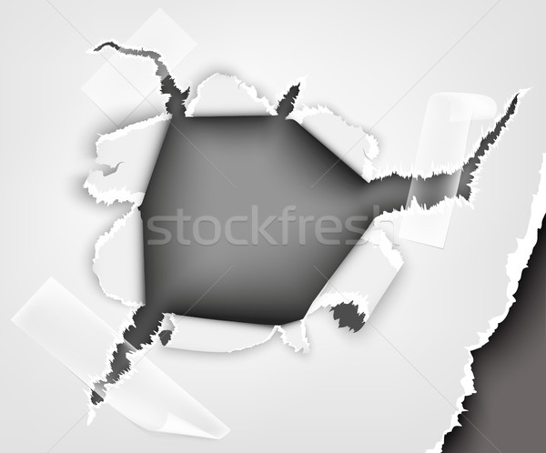 hole in torn paper hole sealed with tape Stock photo © Panaceadoll