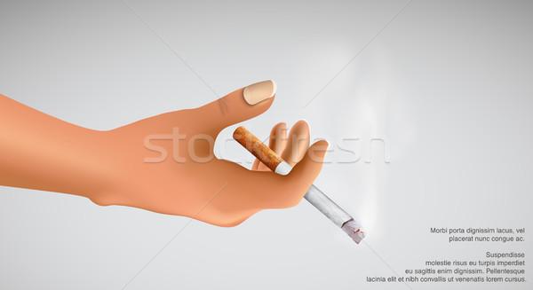 Smoking kills! hand holding a smoking cigarette Stock photo © Panaceadoll