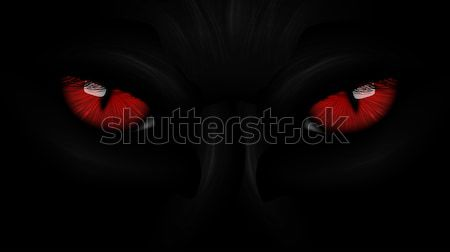 Stock photo: red eyes black Panther on dark