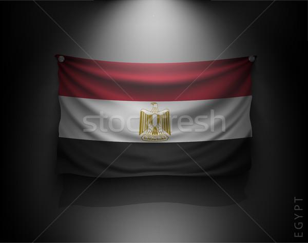 Stock photo: waving flag on a dark wall with a spotlight, illuminated