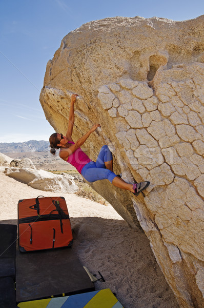 Woman Climbing Boulder Stock photo © pancaketom