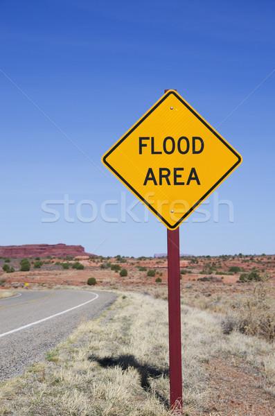 Alluvione segno verticale immagine deserto cielo blu Foto d'archivio © pancaketom