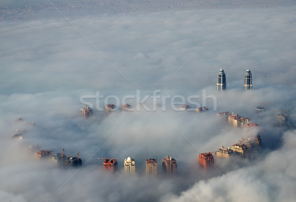 Stock photo: Buildings Rise Above Fog