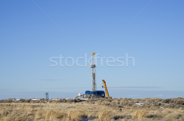 distant drill rig Stock photo © pancaketom