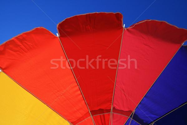 Guarda-sol borda colorido blue sky azul vermelho Foto stock © pancaketom