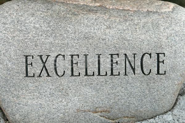 Mükemmellik kelime granit kaya taş harfler Stok fotoğraf © pancaketom