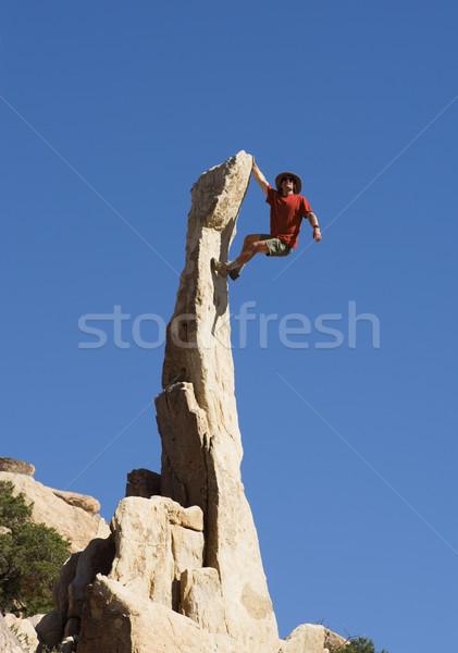 Man Climbing Rock Spire Stock photo © pancaketom