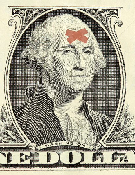 Washington dollar portrait with bandages Stock photo © pancaketom