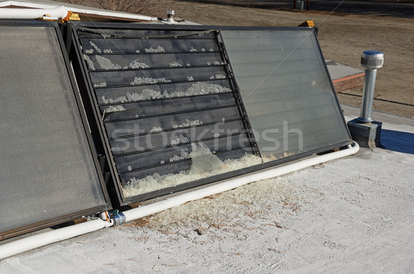 Broken Solar Collector Stock photo © pancaketom