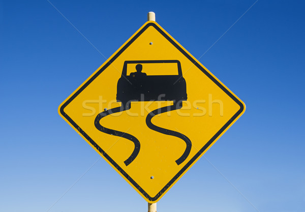 Caution Slippery Road Sign Stock photo © pancaketom