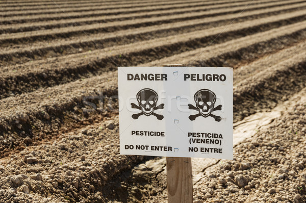 Danger Pesticide Sign In Field Stock photo © pancaketom