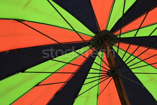Guarda-sol pormenor verde laranja azul Foto stock © pancaketom