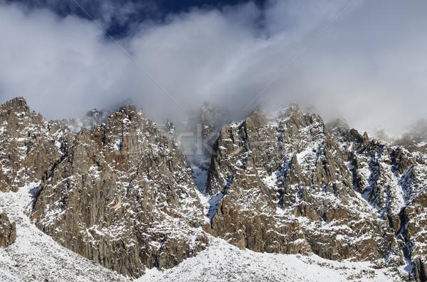 Snowy Cliffs With Clouds Stock photo © pancaketom