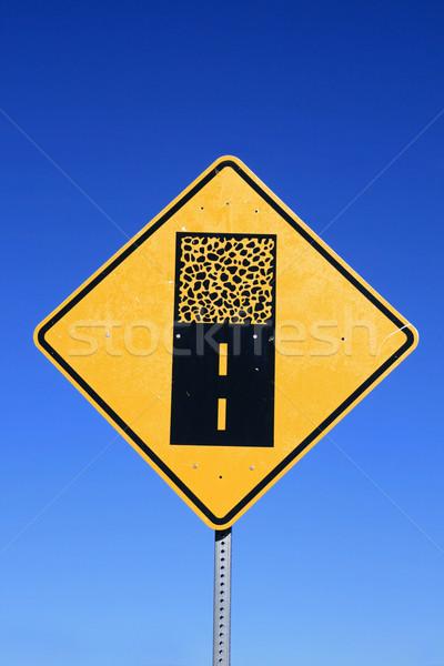 Kavicsút felirat figyelmeztetés apró út felület Stock fotó © pancaketom