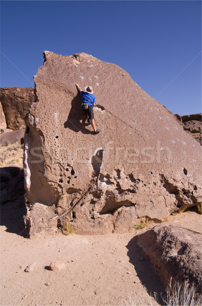 man climbing boulder Stock photo © pancaketom