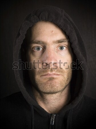gritty hooded man Stock photo © pancaketom