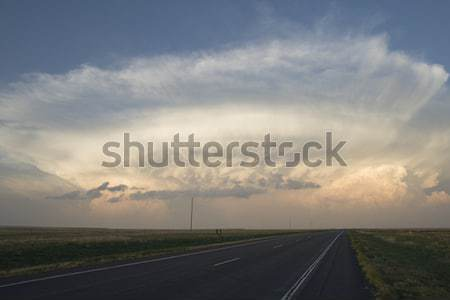 Tempestade nuvem acima horizonte noite estrada Foto stock © pancaketom