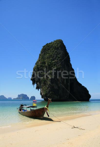 long tail boat on tropical beach Stock photo © pancaketom