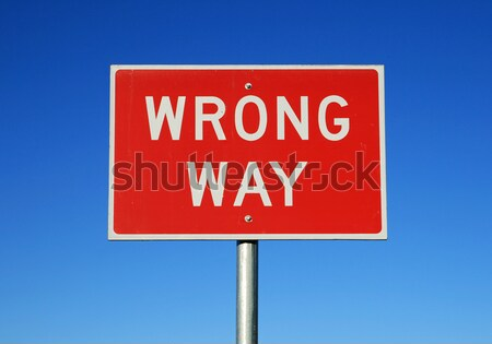 wrong way sign Stock photo © pancaketom