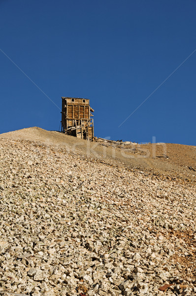 Distant Hilltop Mine Ruins Stock photo © pancaketom
