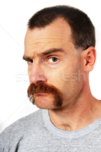 man with mustache raising one eyebrow Stock photo © pancaketom
