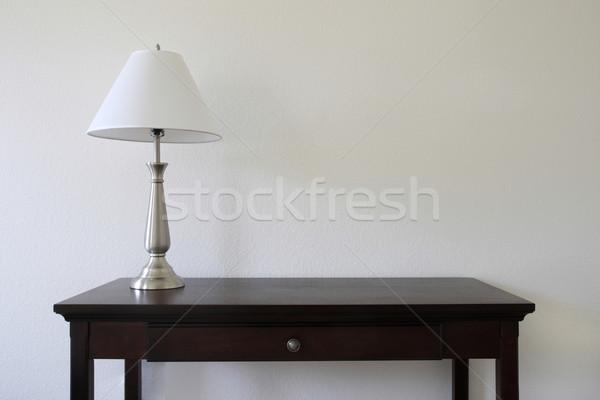 Lámpa asztal ezüst ül fa asztal fehér Stock fotó © pancaketom