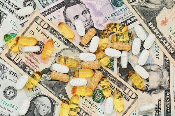 Tabletták pénz drog papír gyógyszer pénz Stock fotó © pancaketom