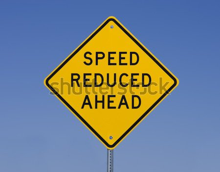 Speed Reduced Ahead Sign Stock photo © pancaketom