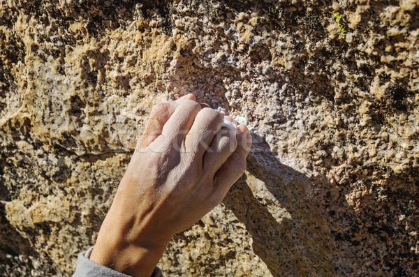 Markolás nő kéz kicsi kő tart Stock fotó © pancaketom