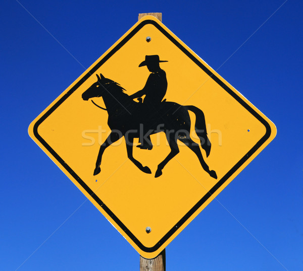 horseback rider road sign Stock photo © pancaketom