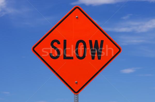 Devagar assinar laranja placa sinalizadora preto cartas Foto stock © pancaketom