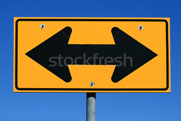 two sided arrow road sign Stock photo © pancaketom