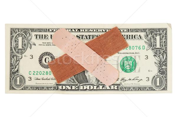 US dollar bill with bandages Stock photo © pancaketom