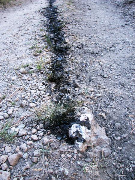 Olie schaal parcours onverharde weg rock Stockfoto © pancaketom