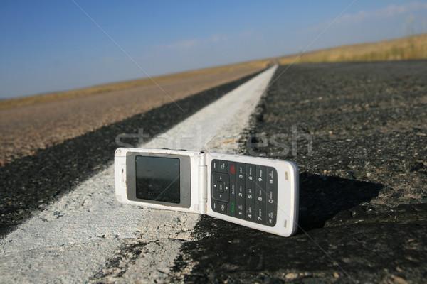 Komórka przydrożny biały w górę telefon komórek Zdjęcia stock © pancaketom