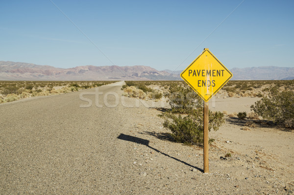 Pavement Ends Road Sign In Desert Stock photo © pancaketom