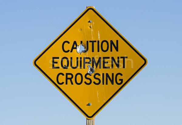Caution Equipment Crossing Sign Stock photo © pancaketom