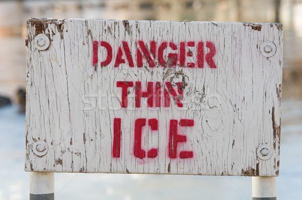 Gevaar dun ijs teken houten witte Stockfoto © pancaketom