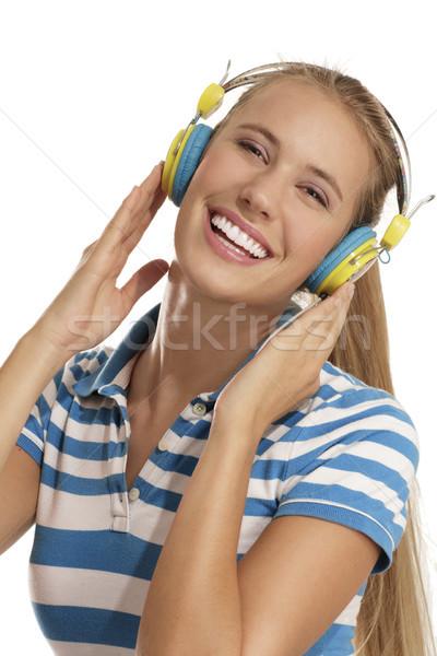 Genç kadın kulaklık beyaz kadın müzik kız Stok fotoğraf © paolopagani