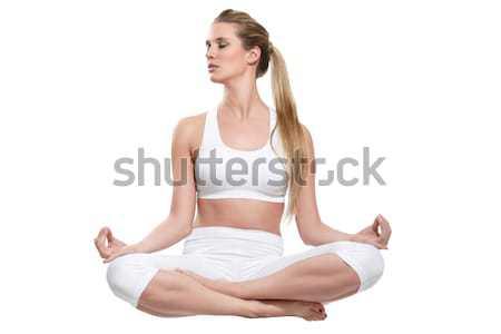 Güzel bir kadın beyaz yoga oturma yalıtılmış kız Stok fotoğraf © paolopagani