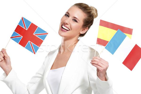 Güzel bir kadın uluslararası bayraklar beyaz kadın Stok fotoğraf © paolopagani