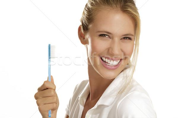 Genç kadın dişler fırçalamak kadın beyaz Stok fotoğraf © paolopagani