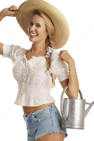 Genç kadın bahçıvan beyaz çiçek gülümseme çalışmak Stok fotoğraf © paolopagani