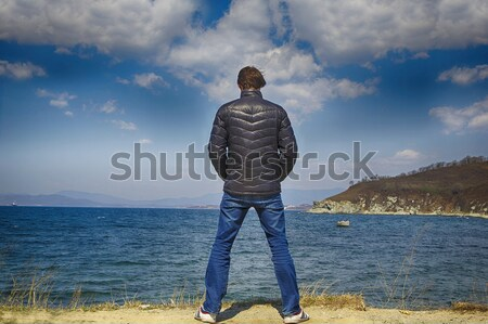 Stock photo: man stands on a background of sea and sun